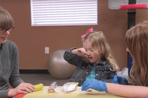 ABC Pediatric Therapy Gross motor skills eating with a spoon