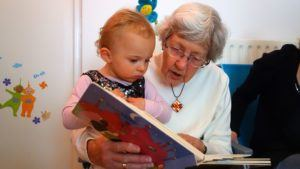 ABC Pediatric Therapy Grandma and Infant looking at book