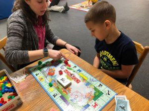 ABC Pediatric Therapy Playing Monopoly
