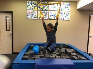 ABC Pediatric Therapy Boy on trapeze swing